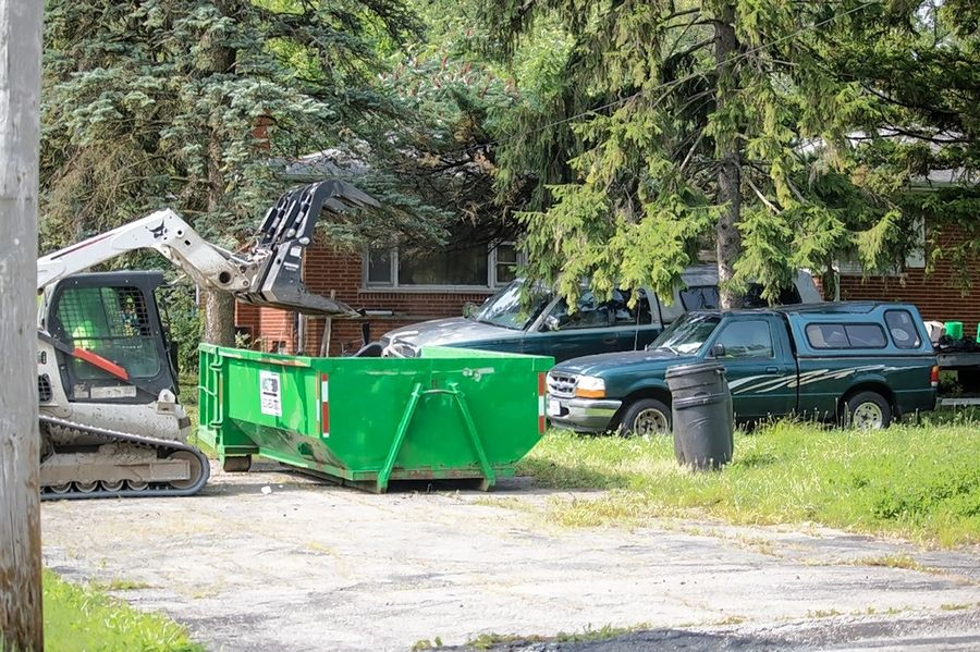 Over a recent two-day span, a group of DuPage County public works employees demolished a garage and removed eight Dumpsters of trash from a property near Lombard.