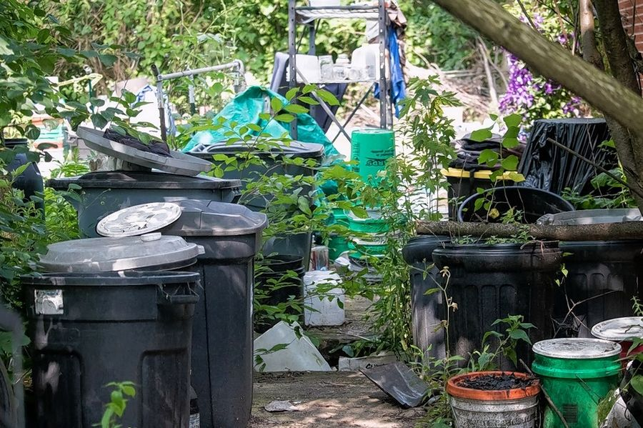 "Junk and debris littered the rear and side yards of a property near Lombard until DuPage County cleaned the site as part of a ""clean and lien"" program."