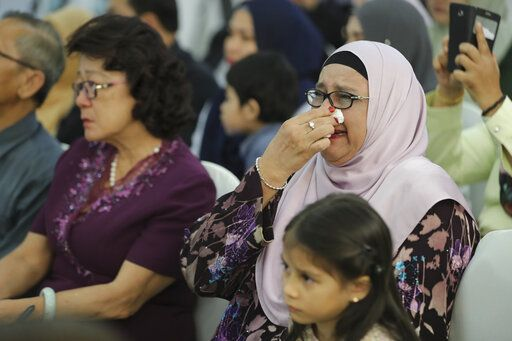 Friends and family of victims from Malaysia Airlines Flight MH17 plane crash attend a ceremony marking the fifth anniversary of the tragedy in Kuala Lumpur, Malaysia, Wednesday, July 17, 2019. Five years after a missile blew Malaysia Airlines Flight 17 out of the sky above eastern Ukraine, relatives and friends of those killed gathered Wednesday in Kuala Lumpur and at a Dutch memorial to mark the anniversary.