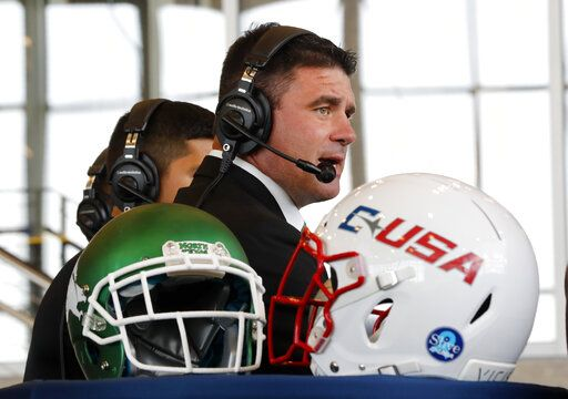 North Texas coach Seth Littrell answers questions in a broadcast interview during Conference USA college football media day, Wednesday, July 17, 2019, in Frisco, Texas.