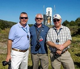 Brothers Mike, John and Bob Cain, third-generation owners of Cain Tubular Products in St. Charles, watch the first test flight of the Orion EFT-1 capsule in 2014. It will be used to return astronauts to the moon in 2024, according to Mike Cain.