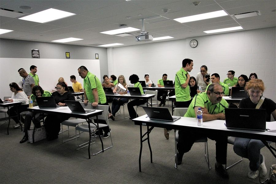 College of Lake County faculty and staff (in green polo shirts) help students enroll in 2018. Sessions on career programs, enrollment and more are part of CLC Days, which run from July 22-25 at the Grayslake, Lakeshore (Waukegan) and Southlake (Vernon Hills) Campuses.
