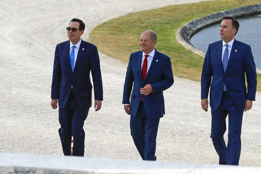 US Treasury Secretary Steve Mnuchin, German Finance Minister Olaf Scholz and Canada's Finance Minister Bill Morneau, from left, walk at the G-7 Finance in Chantilly, north of Paris, on Wednesday, July 17, 2019. The Group of Seven rich democracies' top finance officials gathered Wednesday at a chateau near Paris in search of common ground on the threats posed by digital currencies.