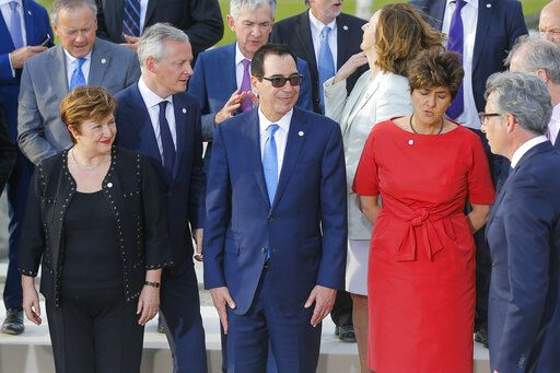 US Treasury Secretary Steve Mnuchin, front center, stands next to Chief Executive of the World Bank Kristalina Georgieva, front left, and Bank of France Deputy Governor Sylvie Goulard, front right, prior a group photo at the G-7 Finance in Chantilly, north of Paris, on Wednesday, July 17, 2019. The Group of Seven rich democracies' top finance officials gathered Wednesday at a chateau near Paris in search of common ground on the threats posed by digital currencies.