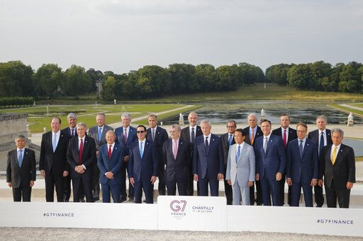 From left, Bank of Japan governor Haruhiko Kuroda, World Bank President David Malpass, Eurogroup President Mario Centeno, British Chancellor of the Exchequer Philip Hammond, Bank of Canada Governor Stephen Poloz, German Finance Minister Olaf Scholz, Federal Reserve Chair Jerome Powell, US Treasury Secretary Steve Mnuchin, Bank of England Governor Mark Carney, Bank of France Governor Francois Villeroy de Galhau, European Commissioner for Economic and Financial Affairs Pierre Moscovici, French Finance Minister Bruno Le Maire, Italian Economy and Finance Minister Giovanni Tria, Japan's Finance Minister Taro Aso, Organization for Economic Cooperation and Development (OECD) Secretary-General Angel Gurria, Canada's Finance Minister Bill Morneau, European Central Bank President Mario Draghi, German Bundesbank President Jens Weidmann, Bank of Italy Governor Ignazio Visco and International Monetary Fund (IMF) Deputy Managing Director David Lipton pose for a group photo at the G-7 Finance in Chantilly, north of Paris, on Wednesday, July 17, 2019.