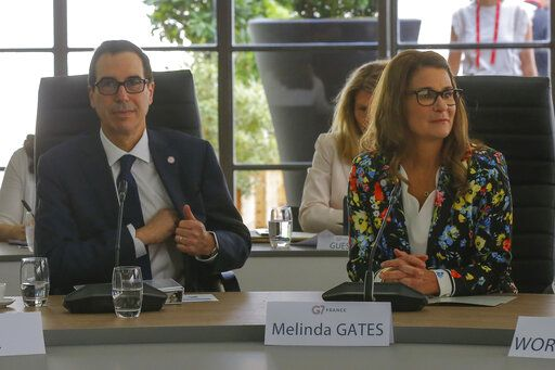 Melinda Gates, right, and US Treasury Secretary Steve Mnuchin attend a meeting at the G-7 Finance in Chantilly, north of Paris, on Thursday, July 18, 2019.