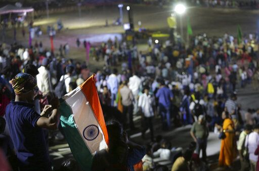 "An Indian spectator folds Indian national flag as others leave after the Chandrayaan-2 mission was aborted at Sriharikota, in southern India, Monday, July 15, 2019. India has called off the launch of a moon mission to explore the lunar south pole. The Chandrayaan-2 mission was aborted less than an hour before takeoff on Monday. An Indian Space Research Organization spokesman says a ""technical snag"" was observed in the 640-ton launch-vehicle system."