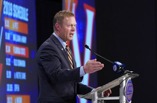 Virginia head coach Bronco Mendenhall speaks during the Atlantic Coast Conference NCAA college football media days in Charlotte, N.C., Thursday, July 18, 2019.