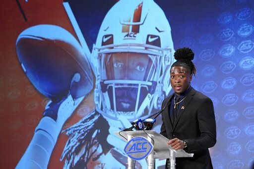 Virginia's Bryce Perkins speaks during the Atlantic Coast Conference NCAA college football media days in Charlotte, N.C., Thursday, July 18, 2019.