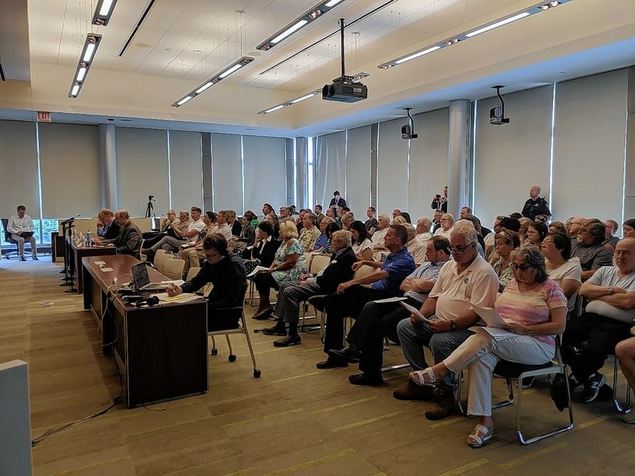 Lake County residents filled Wheeling's village hall chambers Friday morning for a hearing on how the Foxconn development in Wisconsin likely will worsen flooding in the suburbs. The hearing was hosted by U.S. Rep. Brad Scheider, a Deerfield Democrat.