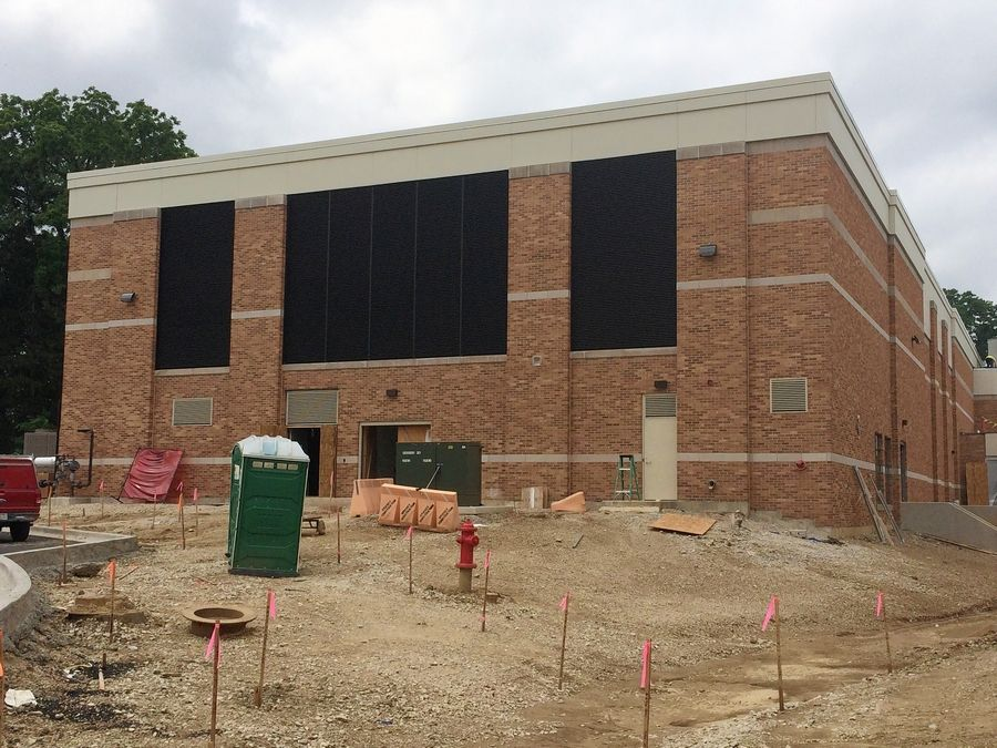 Construction of a new indoor swimming pool at Libertyville High School continued Friday. The pool will have eight lanes and be 50 meters long.