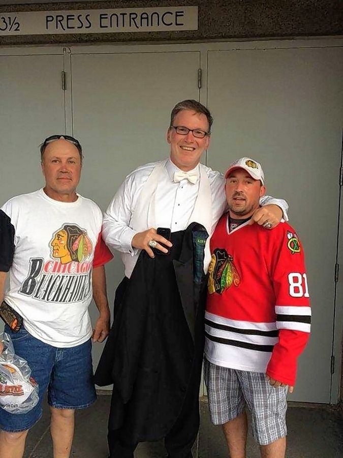 Justin Burau, right, with his dad Wally, left, and Blackhawks national anthem singer Jim Cornelius.