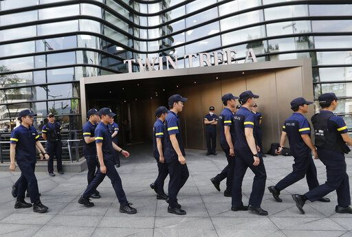 South Korean police officers patrol against possible rallies against Japan in front of a building where the Japanese embassy is located in Seoul, South Korea, Friday, July 19, 2019. South Korean police say a man has set himself on fire in front of the Japanese Embassy in Seoul amid rising trade disputes between Seoul and Tokyo.