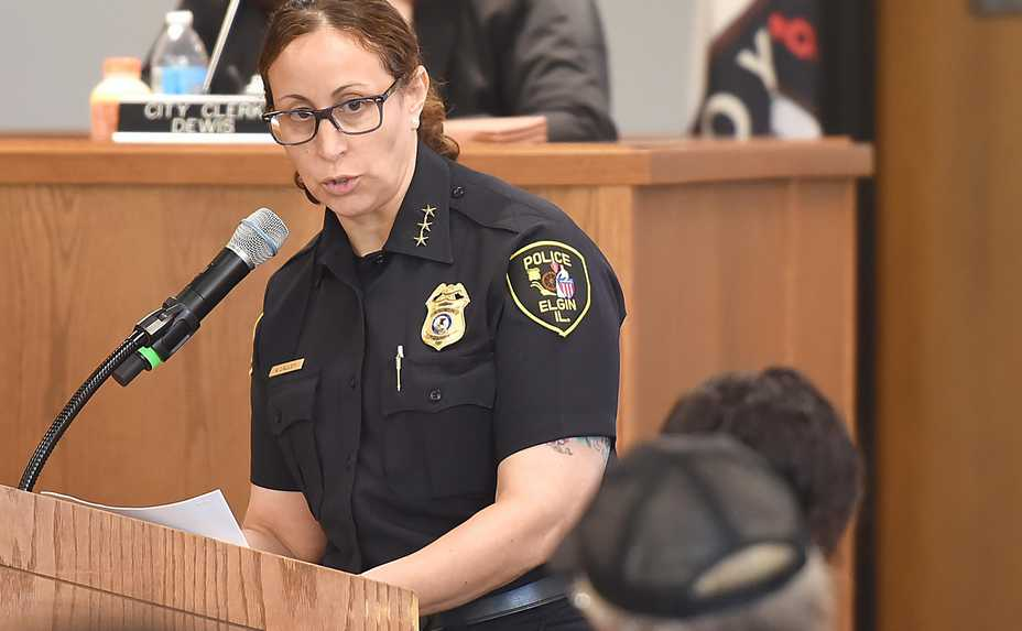 Elgin Police Chief Ana Lalley looks toward Charles Clements after the firm Hillard Heinze presented the results of its investigation into the fatal police shooting of Clements' daughter Decynthia at a special meeting Saturday morning in Elgin.