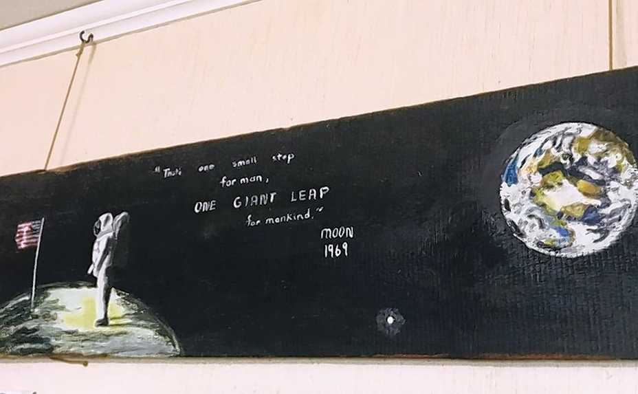 The moon landing 50 years ago was so inspiring, Burt Constable's sister Sally painted this lunar scene on a century-old piece of wood salvaged from the barn on their family farm.