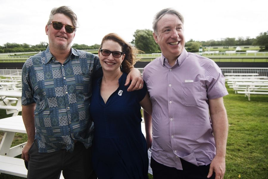 Mike Spellman's sister, Peggy Jacobs of San Francisco, her husband, Craig, left, and brother Neal Spellman attend a gathering prior to the running of the Mike Spellman Memorial Handicap, held in honor of the late Daily Herald sports winter, at Arlington International Racecourse Saturday.