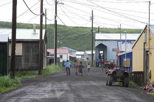 In this Wednesday, June 26, 2019 photo, children play on the main road of Stebbins, a Bering Strait village that is home to 646 people, in Alaska. The city is among over a dozen cities in Alaska that have employed police officers whose criminal records should have prevented them from being hired under state law, the Anchorage Daily News and ProPublica reported Saturday, July 20. (Bill Roth/Anchorage Daily News via AP)