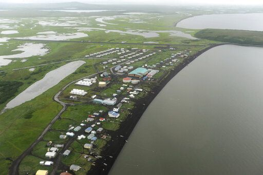 This Wednesday, June 26, 2019 photo shows an aerial view of the Yup'ik village of Stebbins on the Norton Sound coast in Western Alaska. The city is among over a dozen cities in Alaska that have employed police officers whose criminal records should have prevented them from being hired under state law, the Anchorage Daily News and ProPublica reported Saturday, July 20. (Bill Roth/Anchorage Daily News via AP)