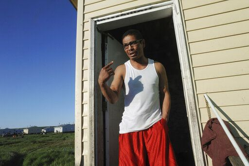 In this Thursday, June 27, 2019, Nimeron Mike speaks from his home in Stebbins, Alaska. Mike, who worked as a village police officer for his hometown of Stebbins from Dec. 31 to March 29, was hired even though he is a registered sex offender and had served six years behind bars in state jails and prisons. Over a dozen cities in Alaska have employed police officers whose criminal records should have prevented them from being hired under state law, the Anchorage Daily News and ProPublica reported Saturday, July 20. (Bill Roth/Anchorage Daily News via AP)