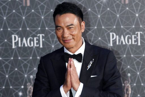 FILE - In this file photo taken Sunday, April 3, 2016, Hong Kong actor Simon Yam poses on the red carpet of the Hong Kong Film Awards in Hong Kong. Yam was stabbed Saturday, July 20, 2019 while attending an event in southern China.