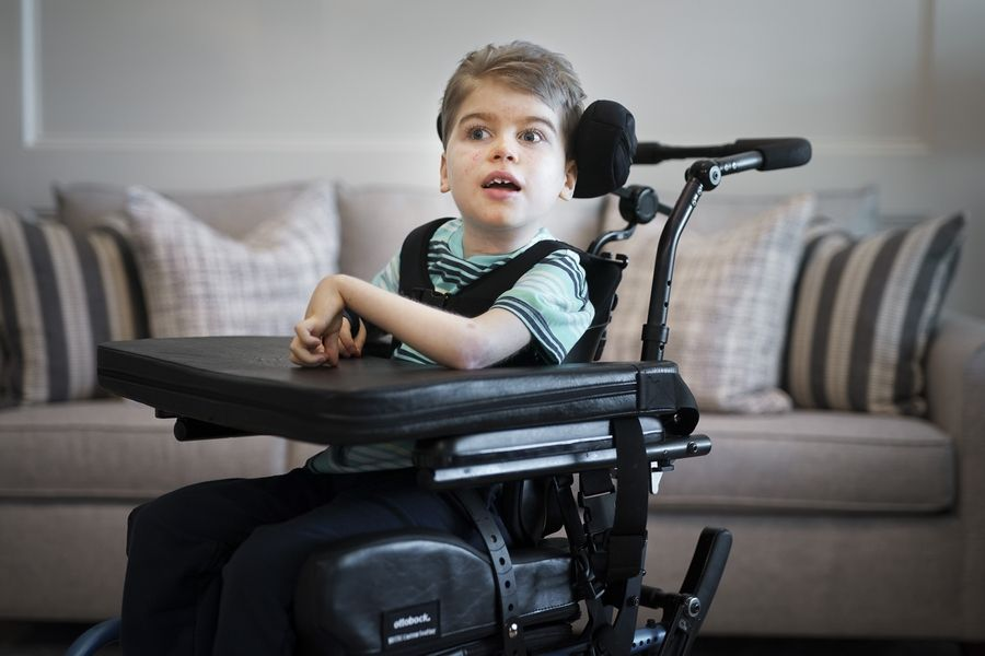 Jacob Helvey, 11, is seen at his home in Alpharetta, Ga. He is unable to walk or talk after being severely injured in a home elevator accident in 2010.