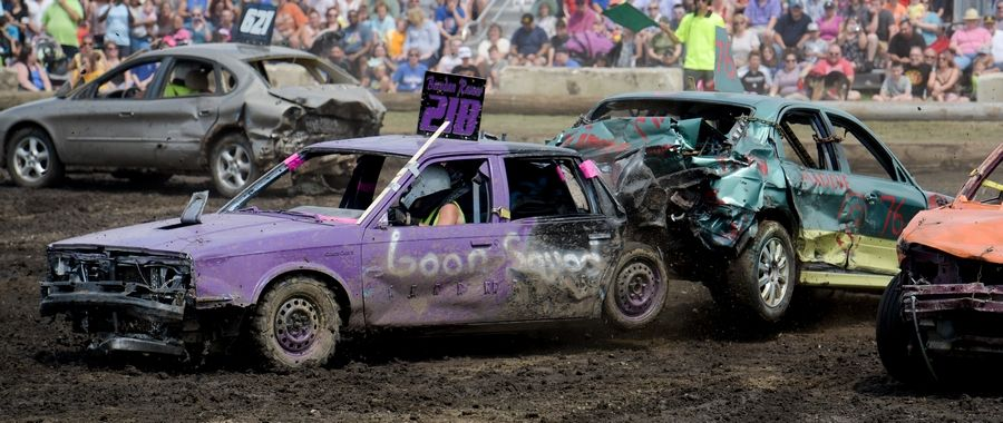 Brendan Ramer of Mendota and John McNicholas of Carol Stream crash into each other during the annual demolition derby on the last day of the DuPage County Fair last year.