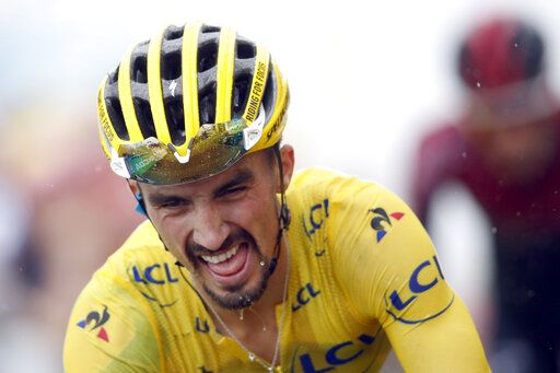 France's Julian Alaphilippe wearing the overall leader's yellow jersey crosses the finish line during the fifteenth stage of the Tour de France cycling race over 185 kilometers (114,95 miles) with start in Limoux and finish in Prat d'Albis, France, Sunday, July 21, 2019.