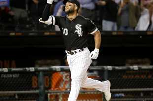 Chicago White Sox's Yoan Moncada celebrates his three-run home run off Miami Marlins starting pitcher Trevor Richards during the fifth inning of a baseball game Monday, July 22, 2019, in Chicago. Leury Garcia and Jose Abreu also scored. (AP Photo/Charles Rex Arbogast)