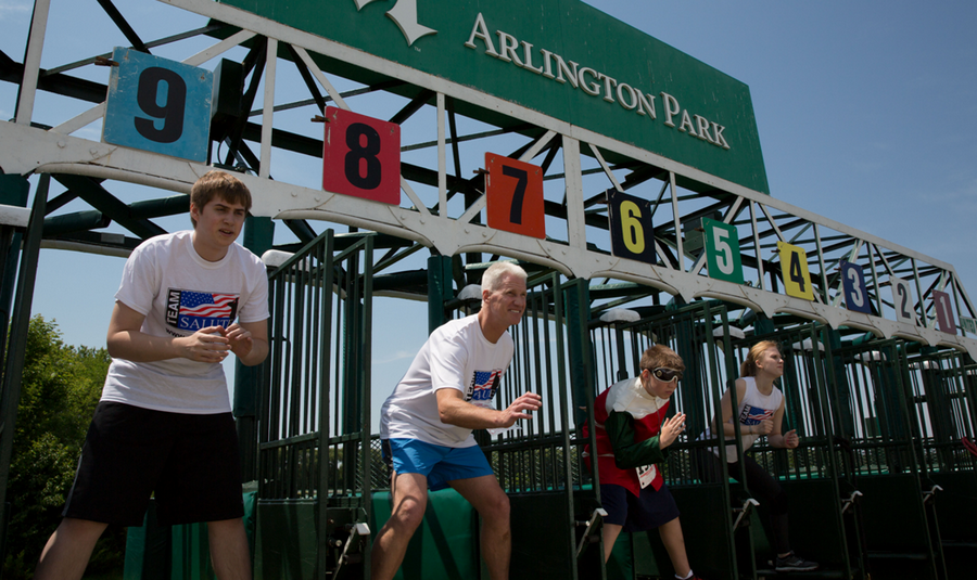 During the Homestretch for Heroes 5K, runners race on the track at Arlington International Racecourse and see their image on the jumbotron as they cross the finish line.
