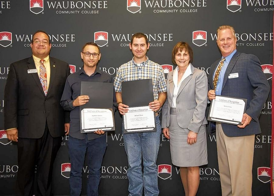 From left, Jimmie Delgado, vice chair of the Waubonsee Community College Board of Trustees; Matthew Maltese; Michael Chinn; Dr. Christine J. Sobek, president of Waubonsee Community College; and Randall Hines, assistant professor of Computer Aided Design and Drafting. Drafting program graduates Chinn and Maltese were recognized by the Waubonsee Board of Trustees at its July meeting.