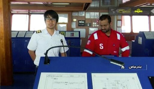 In this photo released by state-run IRIB News Agency, which aired on Monday, July 22, 2019, shows members of the crew of the British-flagged tanker Stena Impero that was seized by Tehran in the Strait of Hormuz on Friday. The Associated Press cannot independently verify the condition of the crew members, but in the video they looked to be in good health and it didn't appear as though they were being filmed under duress. (IRIB News Agency via AP)