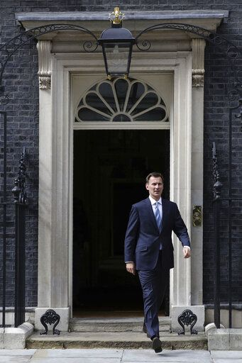 "Britain's Foreign Secretary Jeremy Hunt leaves 10 Downing Street, following a meeting held over British oil tanker Stena Impero which was captured by Iran, Saturday July 20, 2019.  Hunt has said Britain's response to Iran's seizure of a British-flagged ship in the Strait of Hormuz ""will be considered but robust.""(Aaron Chown/PA via AP)"