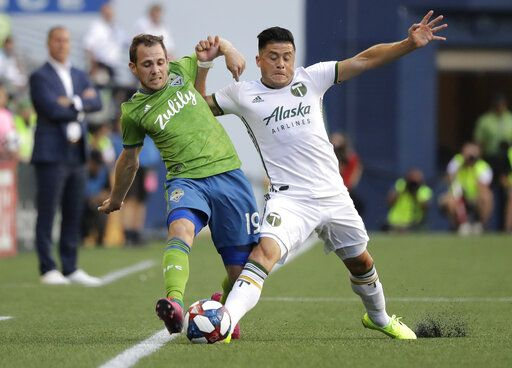Seattle Sounders midfielder Harry Shipp, left, is challenged by Portland Timbers defender Jorge Moreira, right, during the first half of an MLS soccer match, Sunday, July 21, 2019, in Seattle.
