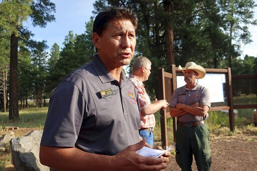 Rich Nieto, incident commander for a wildfire burning near Flagstaff, Ariz., talks about firefighting strategy Tuesday, July 23, 2019. Anxious residents packed up prized possessions as hundreds of firefighters worked to keep a wildfire in a forested Arizona city away from homes and hoped the weather might bring some relief.