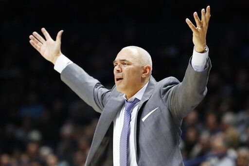 FILE - In this Feb. 9, 2019, file photo, DePaul head coach Dave Leitao reacts during the second half of an NCAA college basketball game, in Cincinnati. The NCAA suspended men's basketball coach Dave Leitao for the first three games of the regular season Tuesday, July 23, 2019, saying he should have done more to prevent recruiting violations by his staff. The NCAA also put the Big East program on three years of probation, issued a $5,000 fine and said an undetermined number of games will be vacated because DePaul put an ineligible player on the floor. An unidentified former associate head coach is also facing a three-year show cause order for his role in the violations.