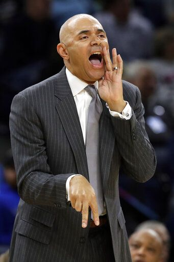 FILE - In this Nov. 15, 2018, file photo, DePaul coach Dave Leitao shouts to his team during the first half of an NCAA college basketball game against Penn State, in Chicago. The NCAA suspended men's basketball coach Dave Leitao for the first three games of the regular season Tuesday, July 23, 2019, saying he should have done more to prevent recruiting violations by his staff. The NCAA also put the Big East program on three years of probation, issued a $5,000 fine and said an undetermined number of games will be vacated because DePaul put an ineligible player on the floor. An unidentified former associate head coach is also facing a three-year show cause order for his role in the violations.