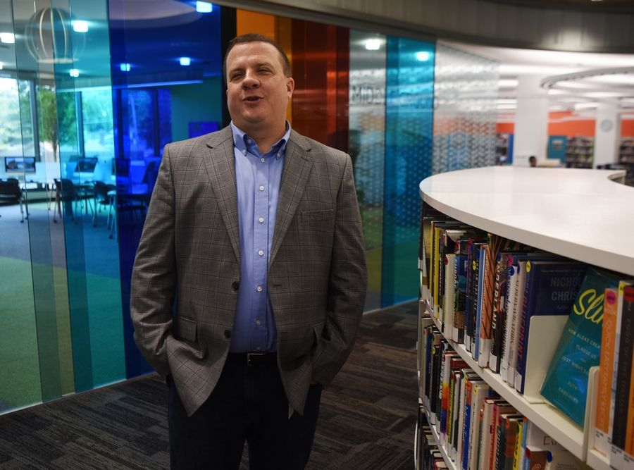Brian Shepard, executive director of the Indian Trails Library District in Wheeling, shows a portion of the recently-renovated library. He has been named Librarian of the Year by the Illinois Library Association.