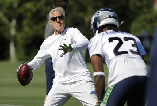 Seattle Seahawks head coach Pete Carroll throws a football during NFL football training camp, Thursday, July 25, 2019, in Renton, Wash.