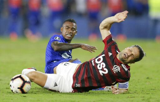 Diego of Brazil's Flamengo reacts after a foul by Dixon Arroyo of Ecuador's Emelec during a Copa Libertadores match in Guayaquil, Ecuador, Wednesday, July 24, 2019.