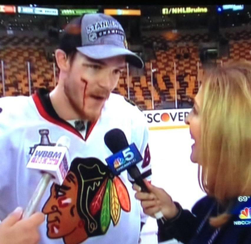Peggy Kusinski interviews Andrew Shaw of the Blackhawks after Game 6 of the 2013 Stanley Cup Finals in Boston.