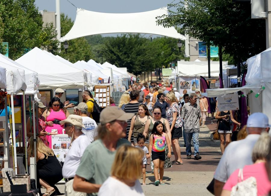 People check out artists booths during the annual Art and Soul on the Fox last year in downtown Elgin.