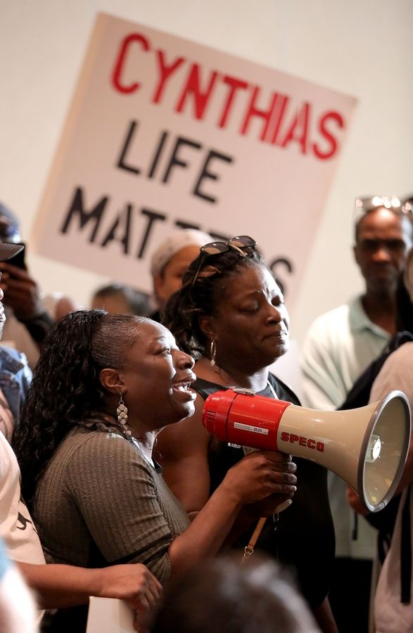 Emmetia Snead, sister of Decynthia Clements, was among about 100 protesters Tuesday who came as the Elgin Police Department held a public question-and-answer session about Clements' shooting.