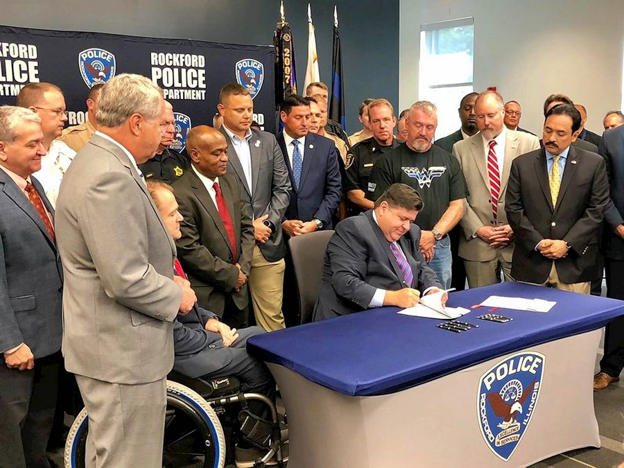 Gov. J.B. Pritzker signs legislation Tuesday that toughens penalties for drivers who do not slow down or move over for parked emergency responder vehicles in Illinois. The bill-signing ceremony has held in Rockford.