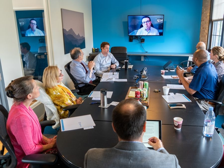 A psychiatrist in Ohio appears on a video conference in the Chicago office of Regroup to explain how that company's telepsychiatry services can make it easier and cheaper to treat patients in prisons or rural areas with a shortage of mental health professionals.