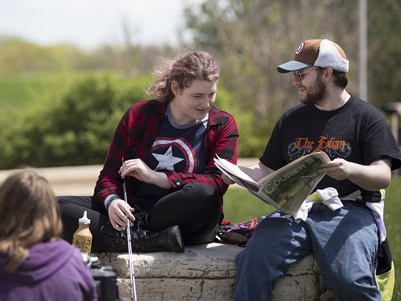 Students take advantage of the warm weather as the summer term winds down at College of DuPage in Glen Ellyn.