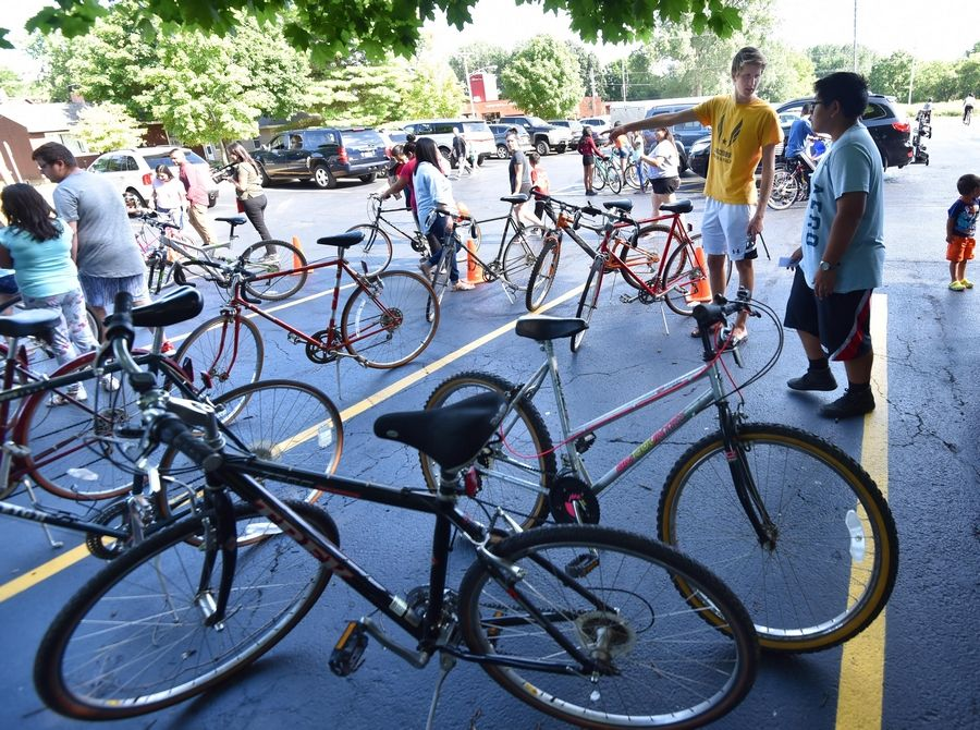 Justin Lorenz, 18, organized a bike giveaway Wednesday for dozens of kids at the Boys and Girls Clubs of Dundee Township.