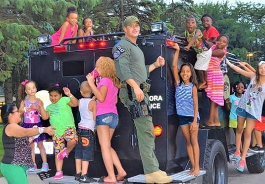 Neighborhood youth hang out with Aurora public safety officials during National Night Out. This year's event will be Tuesday, Aug. 6.