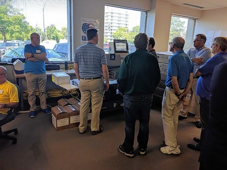 Lake County Clerk's Office employees and representatives from the Republican and Democratic parties observe a high-tech vote counting machine Thursday during a recount of the 2018 Lake County sheriff's race.