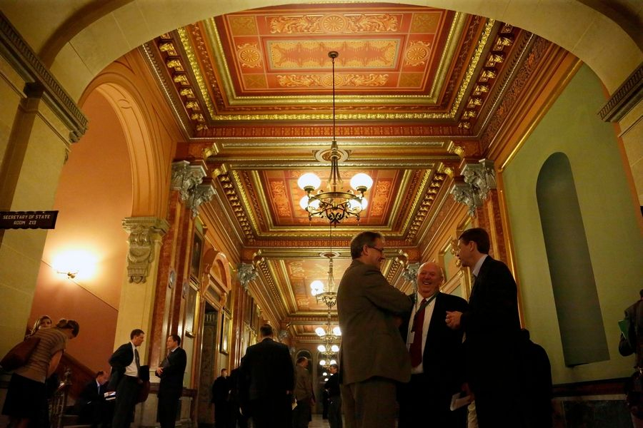 Lobbyists, lawmakers and staff members gather at the Capitol in Springfield. Illinois law places no restrictions on the ability for public officials to become lobbyists.