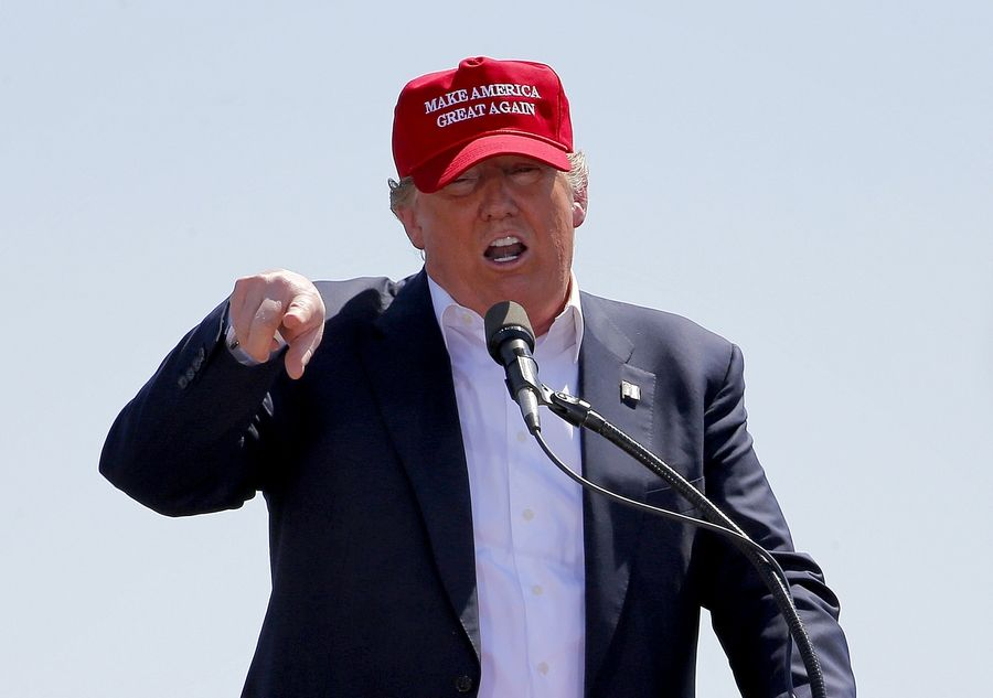 "Then-candidate Donald Trump wore his ""Make America Great Again"" hat at a 2016 stop in Arizona."